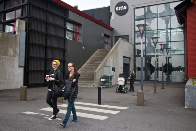 Jóna Venned walks with a friend outside of the SMS shopping center in Tórshavn. Jóna has been abroad to work in Switzerland and travel and visit friends in several other countries. She will leave next year to study in Denmark, but plans to move back home to the Faroe Islands afterward.