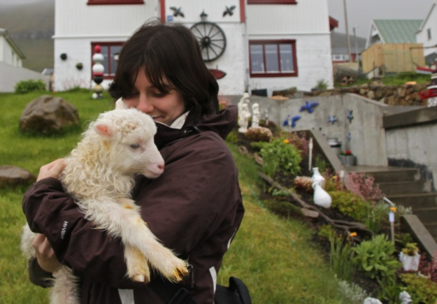 Holding a heimalamb, a lamb raised at the farmer's home because its mother didn't want it. Cute, right?