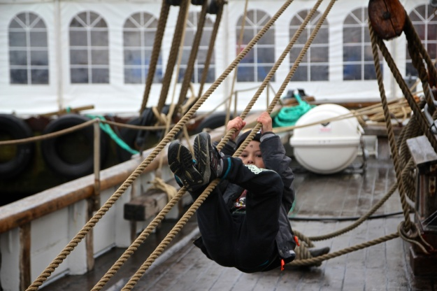 Vágur: A child plays on the Johanna TG 326 during the celebration of the boat's 130th birthday.