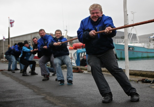Tug of War is serious business at a boat's birthday party in the village of Vágur on Suðuroy.