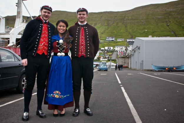 A young Thai-Faroese woman attends the Joansøka festival in Vágur, Suðuroy, with her boyfriend and another friend.