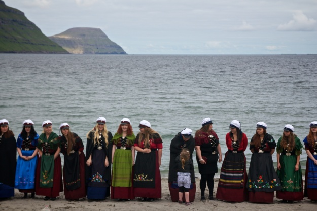 Graduates of the Studentaskúlin (junior college) in Eysturoy gather on the beach in Gøtu as part of their graduation ceremony. This year's graduating class was more than two-thirds female.