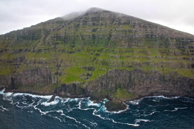 The cliffs of Svínoy in Fugloyarfjørður, where the Jólaskipið met its end.